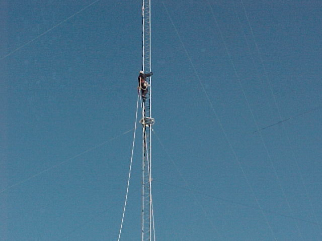 Andrew taking the lifting rope up the tower